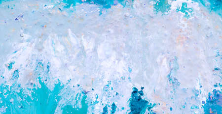 Abstract acrylic gouache paint background. White blue color blend similar to waterfall whitecaps. Art painting technique.