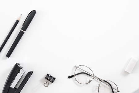 Business routine essentials. Office supplies set. Flat lay of stationery and eyeglasses over white background. Copy space. 写真素材