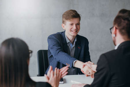 Successful job interview. Professional career. Human resources. Young male applicant got hired for the position. Stock Photo