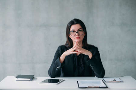 Leadership and successful career. Portrait of powerful business woman in eyeglasses, with confident facial expression.