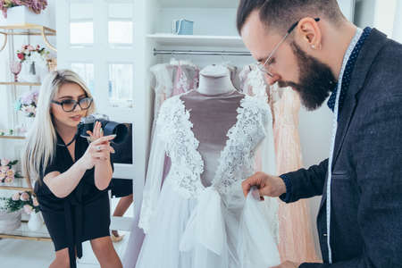 Fashion boutique and store advertising. Clothing brand promotion service. Personal assistant and photographer presenting gowns.