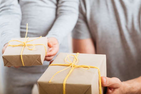 Special day. Cropped shot of caring child and father giving presents to mother.