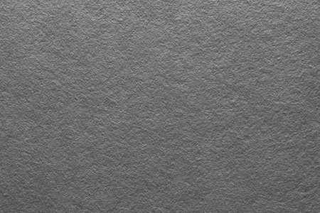 Fondo di arte astratta di struttura del feltro grigio. Superficie in fibre di tessuto colorato. Spazio vuoto.