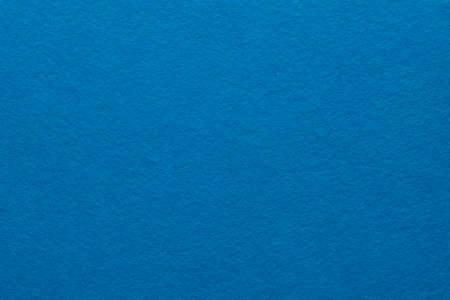 Blue felt texture abstract art background. Colored fabric fibers surface. Empty space. 版權商用圖片