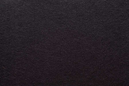 Dark brown felt texture abstract art background. Colored fabric fibers surface. Empty space.