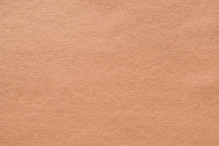 Fondo di arte astratta di struttura del feltro beige. Superficie in cartone tinta unita. Copia spazio.