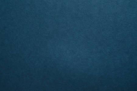 Dark blue felt texture abstract art background. Colored carton surface. Copy space.