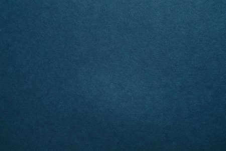 Dunkelblauer Filz Textur abstrakte Kunst Hintergrund. Farbige Kartonoberfläche. Platz kopieren.