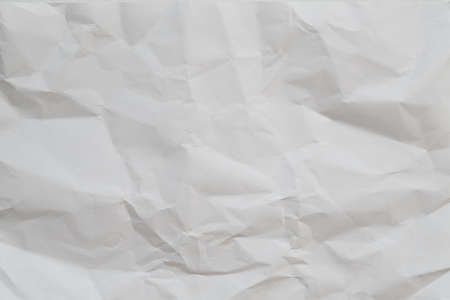 White crumpled paper abstract art background. Wrinkled texture effect. Copy space.