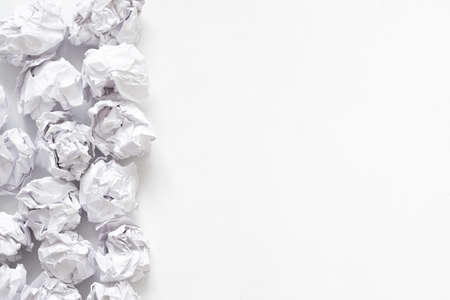 Forest protection. Flat lay of crumpled paper ball pile on white surface. Abstract background. Copy space. Stockfoto