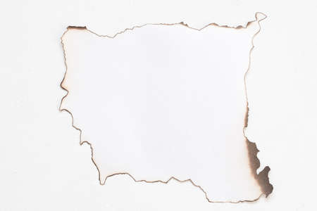 Flat lay of burnt edge sheet of paper mockup on white surface. Abstract background. Copy space.