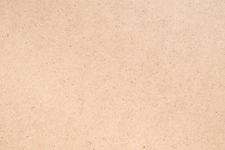 Beige plywood texture abstract art background. Solid color fiberboard surface. Empty space. Imagens - 124623449