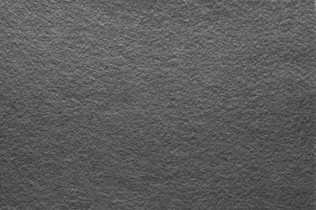 Asphalt gray felt texture abstract art background. Solid color material with grain surface. Empty space. Standard-Bild