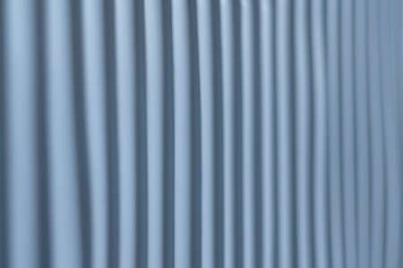 Ribbed texture surface. Vertical striped steel color wall. Blur abstract background. Copy space.