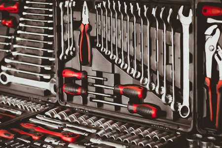 Mechanic essential instruments. Closeup of chrome wrench tools organized in box. Stok Fotoğraf