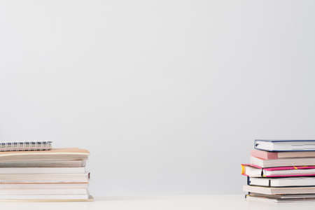 Education and knowledge. Book stacks on desk over white background. Empty space.