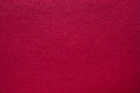 Maroon red felt texture abstract art background. Corduroy textile pattern surface. Copy space.