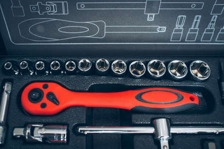 Vehicle service station. Mechanic workshop essential instruments. Closeup of open box with wrench tools set.