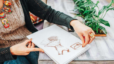 Hobby and talent. Cropped shot of lefthanded female fashion designer drawing sketch in studio. Stok Fotoğraf - 125408690