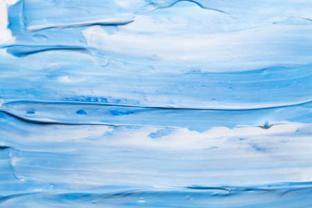 Blue and white acrylic paint art background. Brushstrokes texture. Sky abstract design. Stock Photo
