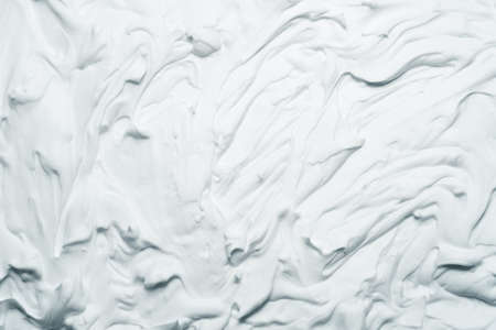 White foam texture abstract art background. Smeared whipped cream design surface. Standard-Bild - 125409215