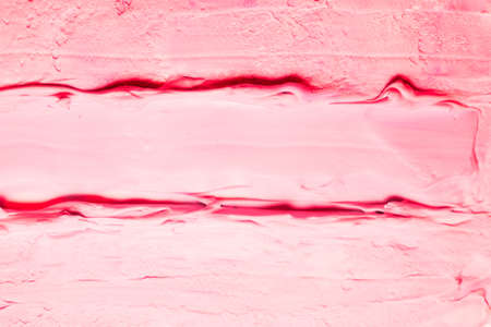 Smeared pink acrylic paint background. Raspberry ice cream effect abstract surface.