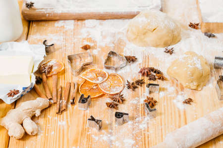 Homemade pastry. Kitchen table mess. Ingredients and tools for making gingerbread biscuits.