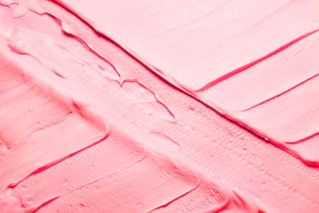 Pink acrylic paint. Art abstract background. Closeup of crossed brushstrokes texture surface.