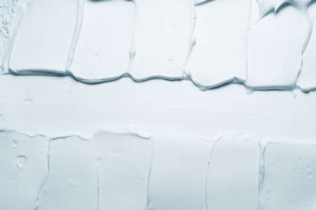 Gray foam texture abstract art background. Smeared tooth paste design surface.
