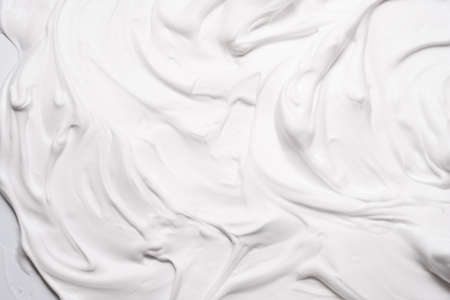 White foam texture abstract art background. Airy mousse decorative pattern wallpaper.