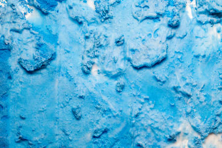 Spilled blue paint art background. Textured colored foam surface with grainy shimmer effect. Standard-Bild - 125409605