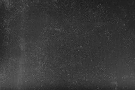 Sovrapposizione effetto scaracchio. Sfondo astratto. Polvere bianca su superficie grigia. Spazio vuoto.