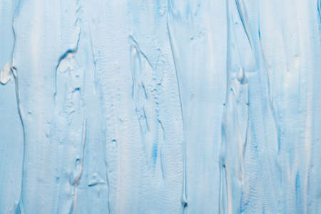 Sky blue acrylic paint art background. Brushstrokes abstract texture. Smeared foam surface. Stock fotó