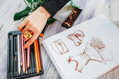 Creativity and inspiration. Cropped shot of female fashion designer drawing sketch in studio.