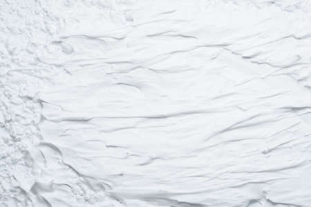 White foam texture abstract art background. Smeared whipped cream design surface. Stockfoto