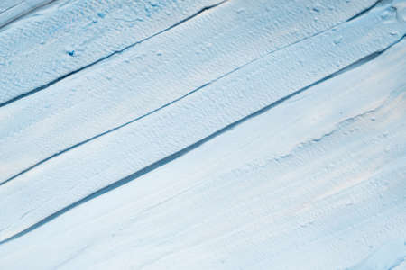 Sky blue acrylic paint. Art abstract background. Closeup of brushstroke layers. Copy space.