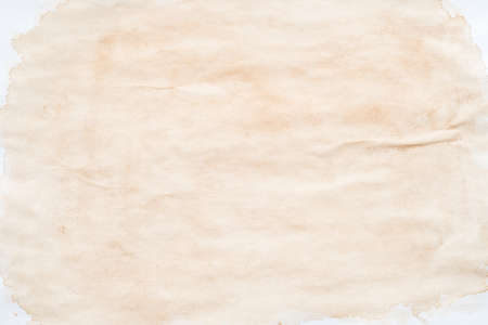 Beige splotch over white surface. Stained paper effect abstract art background. Copy space.