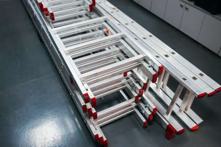 Aluminum extension ladders display. Construction industry equipment retail shop.
