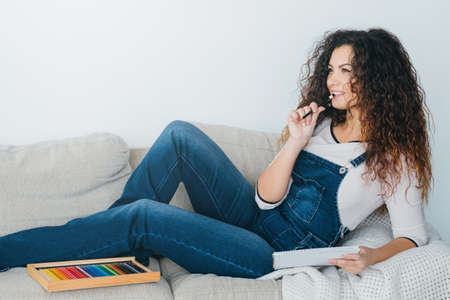 Art hobby and leisure. Inspired lady feeling relaxed on couch at home, thinking on new artwork design. Copy space. Stock fotó - 126917074