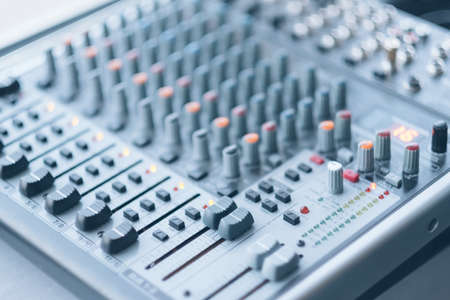 Sound recording studio. Electronic device for combining sounds. Closeup of professional audio mixer.