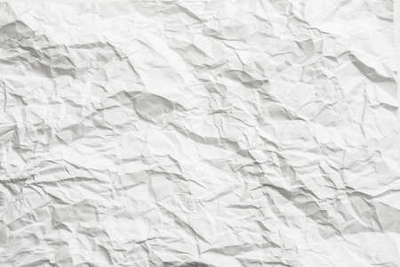 White crumpled paper with gray shades. Minimalist design decorative layer. Empty space. Stock Photo