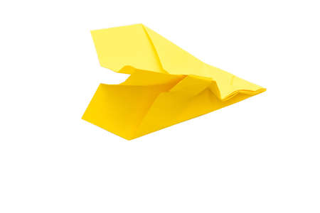Never give up. Yellow wrinkled paper airplane isolated on white background. Copy space. 免版税图像