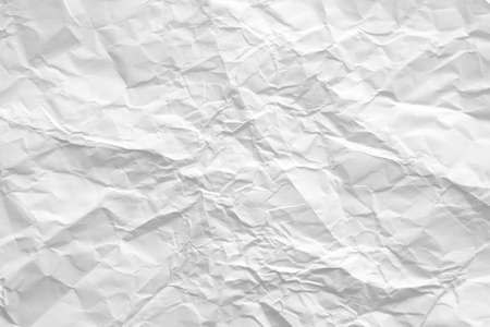 Blank white crumpled paper. Wrinkled texture. Eco friendly material. Abstract art background. Copy space.