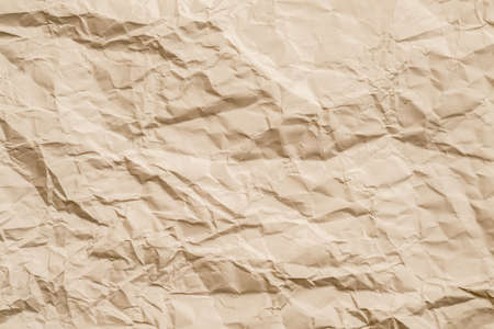 Blank beige crumpled paper. Aged effect. Biodegradable material. Abstract art background. Copy space.