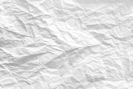 White wrinkled paper sheet. Creased pattern. Eco friendly material. Abstract art background. Copy space.