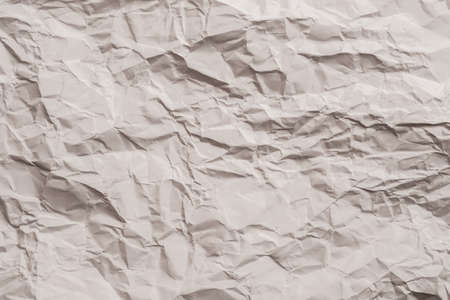 Beige wrinkled paper. Waste recycling concept. Abstract art background. Copy space.