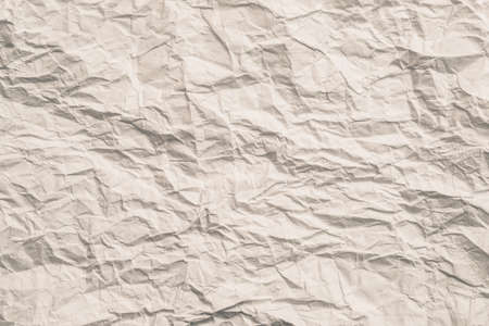 Beige wrinkled paper. Zero waste, reuse concept. Abstract art background. Copy space.