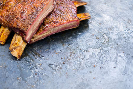 Food delivery service. Grilled meat menu. Closeup of smoked beef ribs. Copy space.
