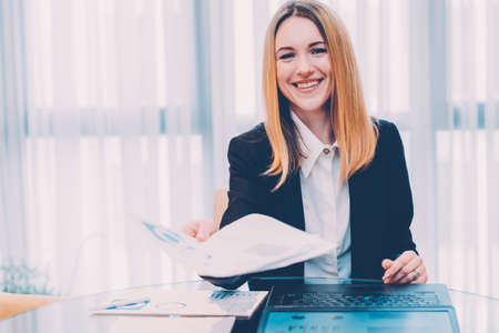 Job interview. Employment and career. Friendly HR manager holding application form. Stock Photo