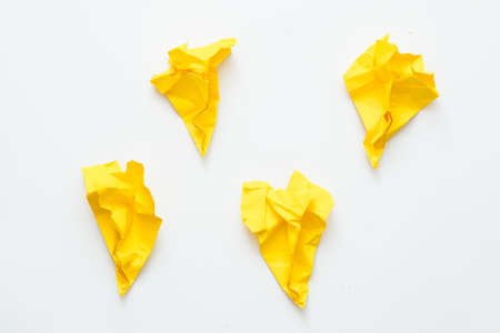 Self actualization failure. Four yellow crushed paper airplanes isolated on white background. Copy space.